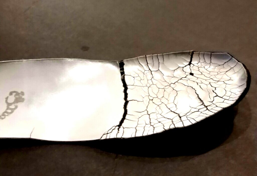 tattered orthotic device in need of repair